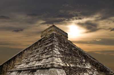 A weak sun peers down at a pyramid